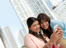 Women using a smart phone Royalty Free Stock Photo