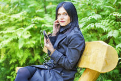 Women using smartphone on the bench Stock Photography