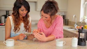 Women using tablet computer stock footage