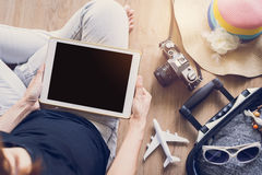 Women using tablet and prepare to travel Stock Images