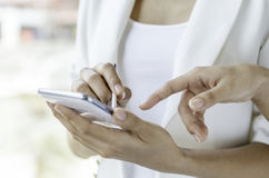 Women using tablet with stylus pen Stock Image