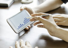 Women using tablet with stylus pen. Close-up of women using tablet with stylus pen Stock Image