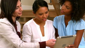 Women using tablet together stock video footage