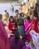 Women in Varanasi. Women in colorful saris on the ghats of the holy city of Varanasi Stock Photos