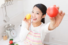 Women with vegetables Royalty Free Stock Photos