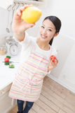 Women with vegetables Stock Images