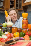 Women with vegetables and jars Royalty Free Stock Photo