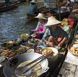 Women vendors selling food from their boats in the Floating Market Stock Image