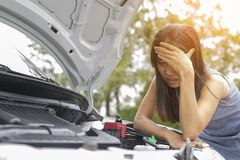 Women are very stressed because of her car breakdown. Concept car broken Royalty Free Stock Photography