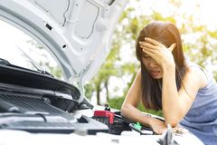 Women are very stressed because of her car breakdown. Royalty Free Stock Photo