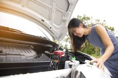 Women are very stressed because of her car breakdown. She did not know what to do Stock Photo