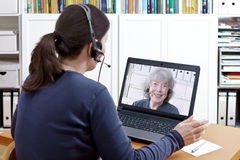 Women video chat grandmother headsets Royalty Free Stock Images