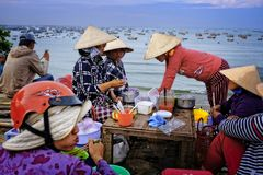 Women in Vietnam eating food. stock images