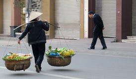 Women in Vietnam wearing traditional triangular straw palm hats Stock Photography