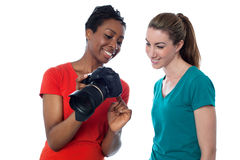Women viewing pictures in the camera Stock Photo