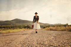 Women with vintage travel suitcase at old road. Photo in image s Stock Photos
