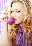 Women in violet. Women with the Christmas toy/the violet lenses Royalty Free Stock Images