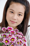 Women and violet flowers Stock Images