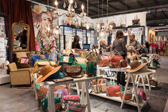 Women visiting a stand displaying bags at HOMI, home international show in Milan, Italy Stock Photo