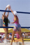 Women Volleyball Players. Female volleyball player blocks a shot at the net, Venice Beach, California Stock Photo