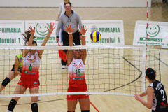 Women volleyball players in action Stock Image