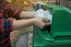 Women volunteer help garbage collection charity. Royalty Free Stock Image