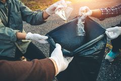 Women volunteer help garbage collection charity. Women volunteer help garbage collection charity environment royalty free stock image