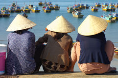 Women wait at Harbour Stock Photo
