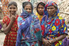Women wait for their men from fishing in Mongla, Bangladesh. Royalty Free Stock Photo