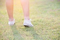 Women walk on grass Royalty Free Stock Photos