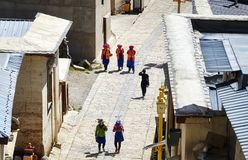 Women walk the road in Songzanlin Monastery. Shangri-La, China - September 25, 2017: Women walk the road in Songzanlin Monastery, built in 1679, is the largest Stock Images