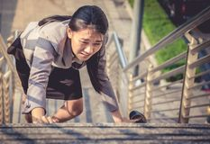 Women walk up the ladder with bare feet and Holding black high h stock photos