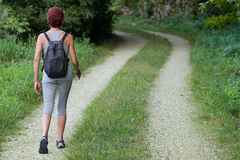Women walk by the way. Royalty Free Stock Photo