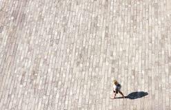 Women walking alone on street. Bird eye view Royalty Free Stock Image
