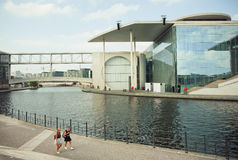 Women walking along Spree river and buiding of German Federal Chancellery Stock Photography