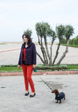 Women walking around town with dachshund dog Royalty Free Stock Photo