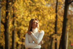 Young women walking autumn park fanny sunny day. Women walking autumn park fanny sunny day royalty free stock photography