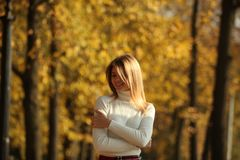 Young women walking autumn park fanny sunny day. Women walking autumn park fanny sunny day stock photography
