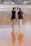 Women Walking Barefoot On Beach Royalty Free Stock Photos