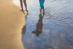 Women walking on beach during sunshine. Photograph of two people walking on the beach in Antalya, Turkey Stock Photos