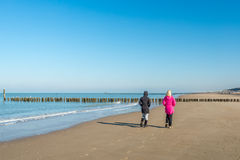 Women walking on the beach Royalty Free Stock Photography