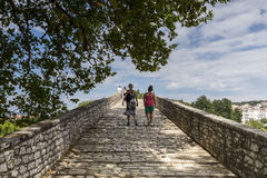 Women walking on the bridge looking at the View of Arachthos riv. Er of Arta city, Epirus Greece Stock Photo
