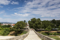 Women walking on the bridge looking at the View of Arachthos riv Royalty Free Stock Photo
