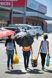 Women walking and carrying shopping in Soweto. stock images