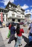 Women walking in front of Palacio Nacional Stock Photo
