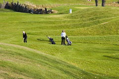 Women Walking Golfers royalty free stock photography