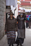 Women walking in the old city of Lhasa in Tibet. stock images