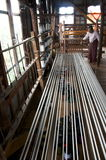 Women walking out silk to get it ready to weave. Burma royalty free stock photo