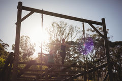 Women walking on outdoor equipment during obstacle course royalty free stock photo