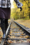 Women walking on rails. In a autumn forest Stock Images